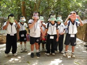 "Children wearing their frog masks at Zoo ""Miguel Alvarez del Toro"" (ZooMAT) in Chiapas, Mexico."