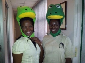 Johannesburg Zoo staff in their special frog hats, showing their support for amphibian conservation.