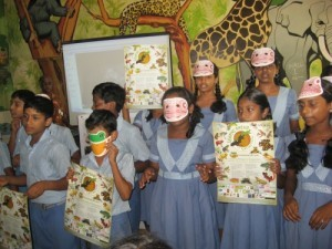 Students with their AArk Leap Day posters and wearing amphibian masks.