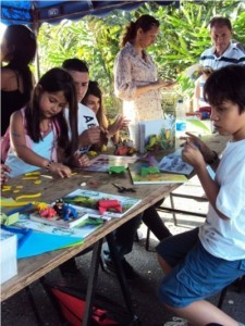 Young visitors to Santa Fe Zoo, making origami and plasticine frogs.
